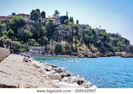 Antalya, Turkey - May 19, 2019: Antalya Coast Stone Embankment And Beach