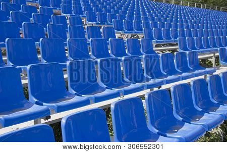 empty spectator seats in the open-air arena poster