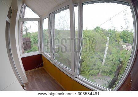 Metal-plastic Doors And Windows In The Loggia Or Balcony. Fisheye Photo