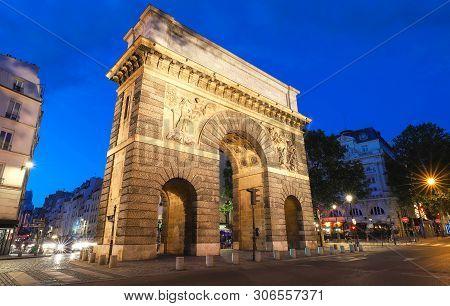 Paris, the porte Saint-Martin, beautiful ancient gate near the Grands Boulevards. poster