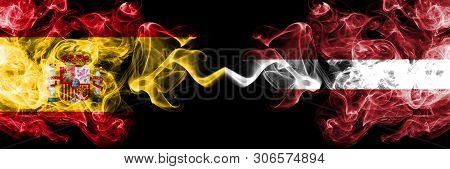Spain Vs Latvia, Latvian Smoky Mystic Flags Placed Side By Side. Thick Colored Silky Smokes Flag Of
