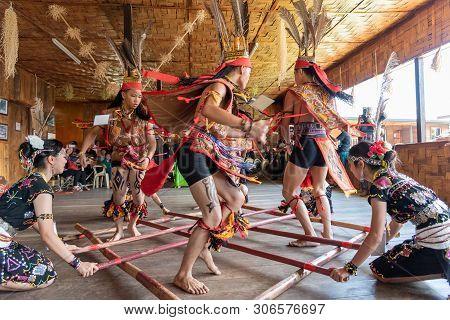 Kota Kinabalu, Malaysia - May 30, 2019: Kadazan Dusun Murut Borneo Native Bamboo Dancing Performance