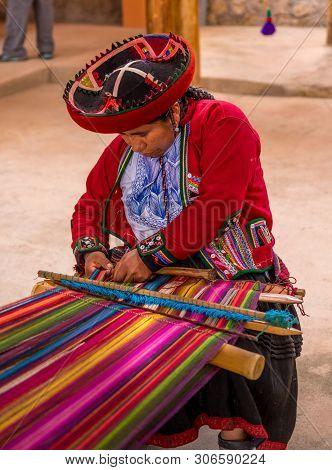 Cuzco, Peru - April 30, 2019. Peruvian Woman Working On Traditional Handmade Wool Production