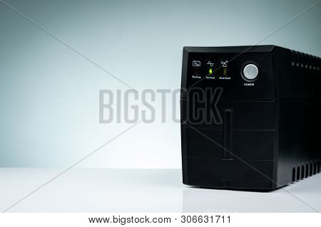 Uninterruptible Power Supply. Backup Power Ups With Battery Isolated On Table. Ups For Pc. Equipment