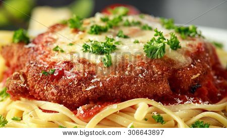 Chicken Parmesan With Cheese And Marinara Sauce Served Over Spaghetti, Pasta