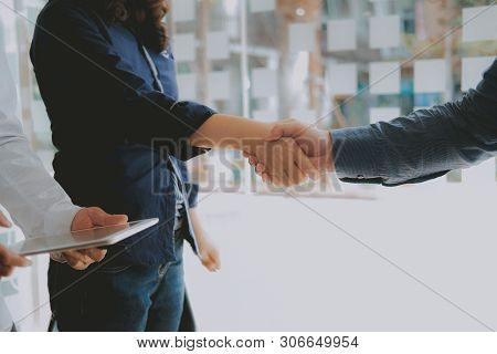 Business People Shaking Hands After Meeting. Colleagues Handshaking. Teamwork Partnership Concept.