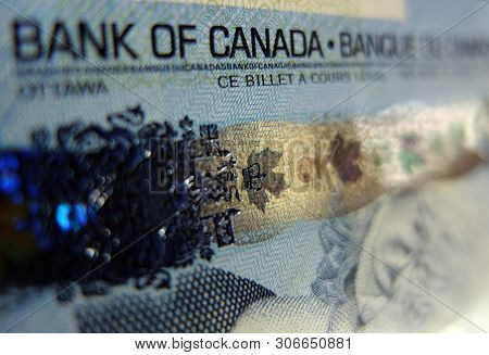 Canadian Five Dollar Bank Note Closeup / Macro. Image Shows The Security Hologram Strip Icons Of Com