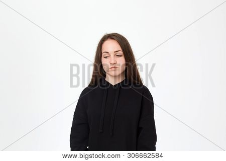 Portrait Of A Sad Brunette Girl Isolated On A White Background.