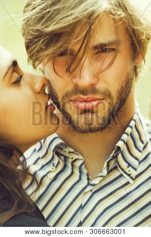 Couple In Love, Girl Or Cute Woman, Pretty Girlfriend Kissing Unshaven Man Or Handsome, Bearded Mach