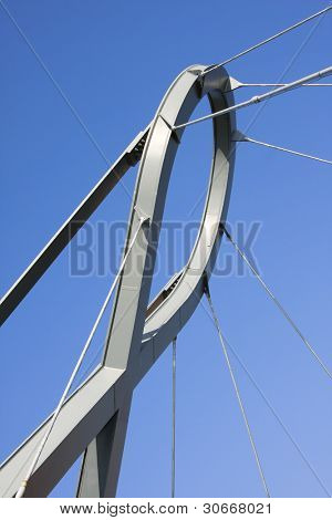 An abstract detail of a futuristic metal structure over a blue sky (abstract wallpaper). Aveiro, Portugal