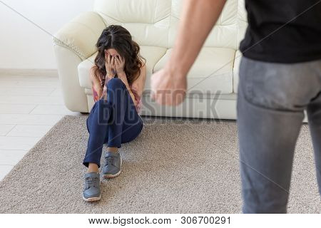 Victim, Domestic Violence And Abuse Concept - Man Threatening With Fist To Crying Woman On Floor Sca