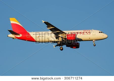 Iberia Express Airbus A320 Ec-jfh Passenger Plane Landing At Madrid Barajas Airport
