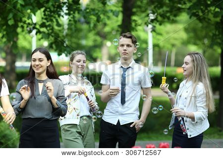 Moscow, Russia, May22,2019: School Students Take Part On Solemn Graduation Prom Day, Play Blowing Wi