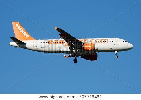Easyjet Airbus A320 G-eztl Passenger Plane Landing At Madrid Barajas Airport