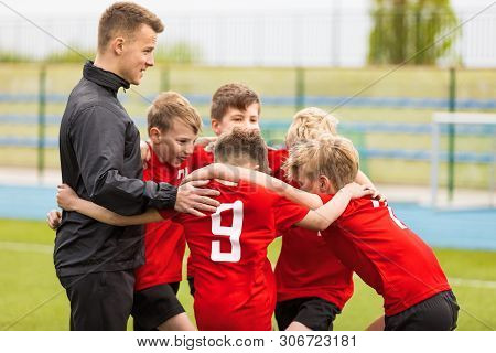 Coaching Youth Sports. Kids Soccer Football Team Huddle With Coach. Children Play Sports Game. Sport