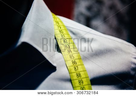Business Shirt Tailoring On Tailor Shop Mannequin With Yellow Measure Tape Across Neck - Personal Ta