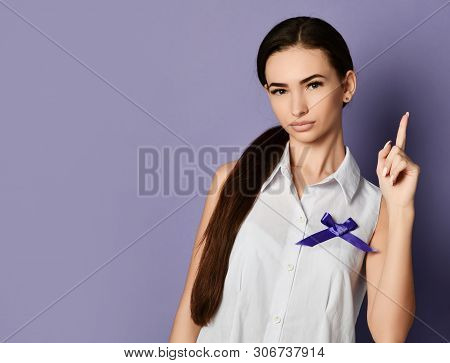 Woman Pointing Finger Up Reminds About The Importance With Purple Ribbon To World Epilepsy Day, Canc