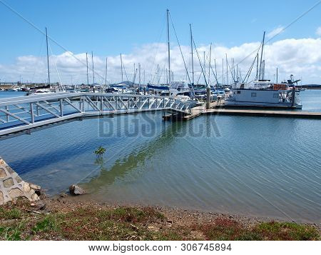 Gladstone Marina. Waterfront Walkway With Boats In Tropical Water With Blue Sky Backdrop. Safe Haven