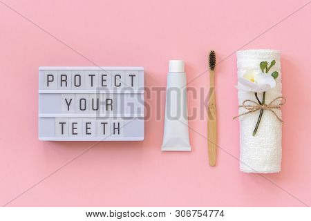 Protect Your Teeth Text On Light Box And Natural Eco-friendly Bamboo Brush For Teeth, Towel, Toothpa