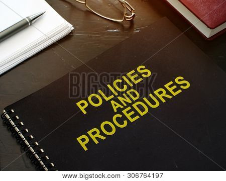 Policies And Procedures Company Documents On A Desk.