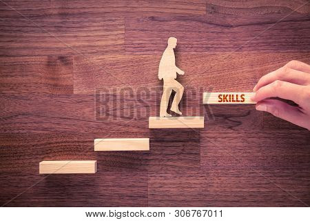 Coach Motivate To Skills Improvement. Hand With The Last Peace Of Stair And Person Made From Wood An