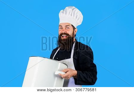 Cook In White Apron With Pot. Master Chef. Cooking, Culinary, Cuisine. Food Preparation Concept. Bea