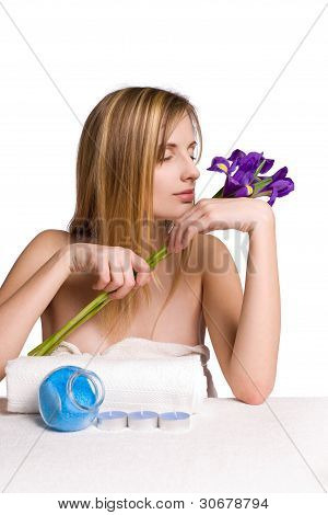 Blond Spa Girl With Iris Flowers.