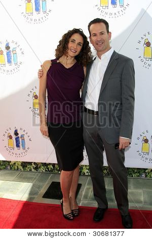 LOS ANGELES - MAR 4:  Melina Kanakaredes, Darryl Frank arrives at the  Have A Dream Foundation's 14th Annual Dreamers Brunch at the Skirball Cultural Center on March 4, 2012 in Los Angeles, CA