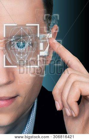 Man In Augmented Reality Glasses With Face Recognition System