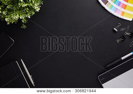 Top View Of Dark Table Graphic Designer With Color Sampler, Tablet And Diary With Copy Space