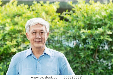 Headshot Of Happy Old Mature Asian With White Grey Hair Man Wearing Blue Shirt Smiling Positive And