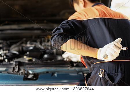 The Car Mechanic Is Checking The Engine Oil Level.auto Mechanic Preparing For The Work.close Up Of H