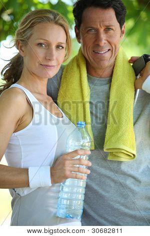 Portrait of couple dressed in sportswear