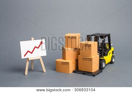 Yellow Forklift Truck With Cardboard Boxes And A Red Arrow Up. Increase Sales, Production Of Goods.