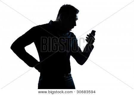 one caucasian man surprised telephone videophone  portrait silhouette in studio isolated white background