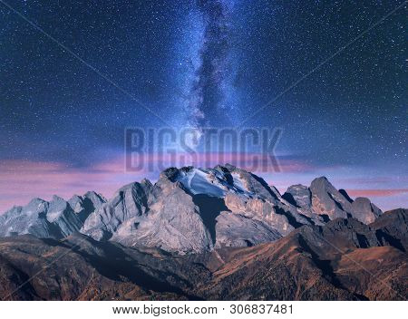 Milky Way Over Mountains At Starry Night In Autumn. Amazing Landscape With Alpine Mountains, Trees,