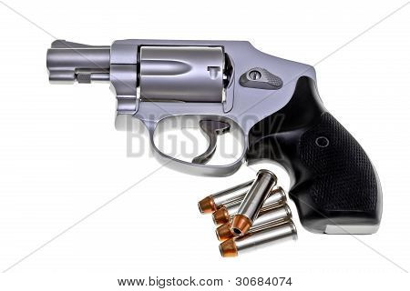 A Modern compact short barrel ultra lightweight titanium revolver with jacketed hollow point high speed ammo cartridges bullets gun Saturday Night Special isolated on white background poster