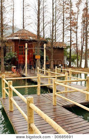 Wood house on lake and path