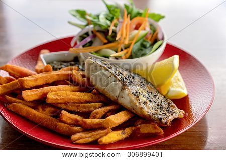 A Typical Aussie Pub Meal Of Grilled Fish, Chips And Salad Served In An Australian Hotel