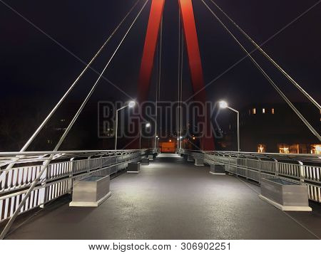 Sidewalk Area Going Through A Cable-stayed Bridge With Big Steel Cables, Closeup At Night Time In Br