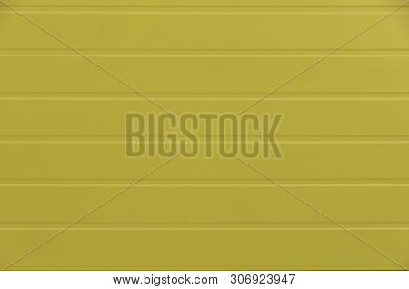 A Corrugated Fence Of Yellow Metal Sheets. Texture Of Metal Fence Picket Profile Decking. Internal P