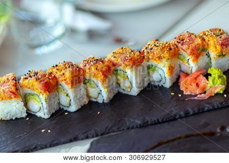 Closeup photo of a sushi roll, traditional tasty Japanese food, healthy nutrition, expensive and dietary dish, menu of an asian cuisine restaurant