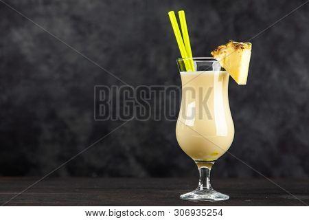 Pina Colada Cocktail on dark background