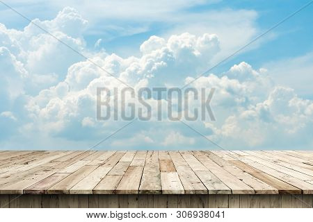 Blue Sky And Wood Floor.empty Wooden Pier At Sunrise A Beautiful Colorful Morning,ready For Product