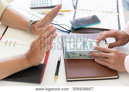 Business And Finance Concept, Hand Of A Businessman Refuse Money From His Partner.