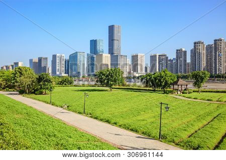 Cityscape and skyline of Fuzhou,viewed from green field in park,Fuzhou,China
