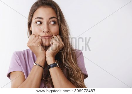 Cute Excited Girlfriend Peeking Aside Amused Leaning Head Hands Entertained Smiling Thrilled Wanna S