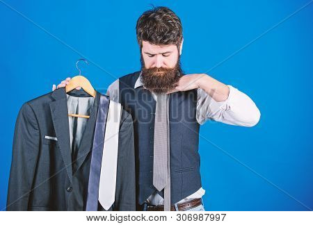 Matching Necktie Outfit. Man Bearded Hipster Hold Neckties And Formal Suit. Perfect Necktie. Shoppin