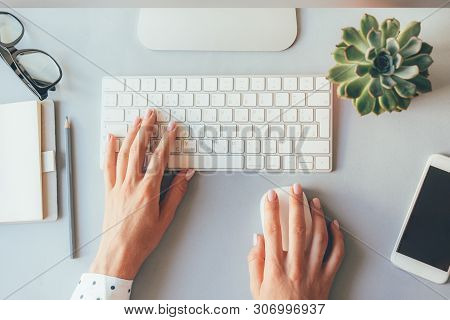 Top View Of The Workplace, Elegant Female Hands On The Keyboard Of A Personal Computer In The Office