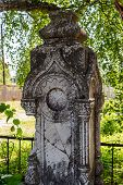 Ancient carved gravestone of stone in the cemetery near the Russian Orthodox Church. Village Spas-Prognanye, Russia poster